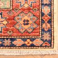 Hand-knotted Fine Afghan Kazak Rug with geometric 3 medallion design set on a beige background.