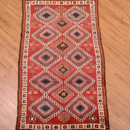 Handmade Old Qashqai Gabbeh Rug with geometric all over design on a red field.