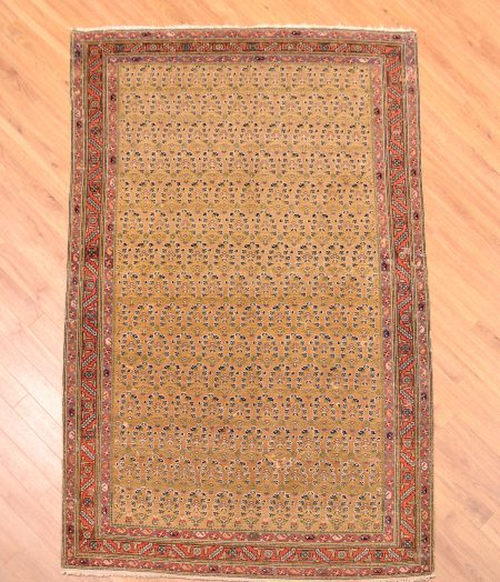 Semi-Antique Malayer Rug with all over boteh design on a gold background.