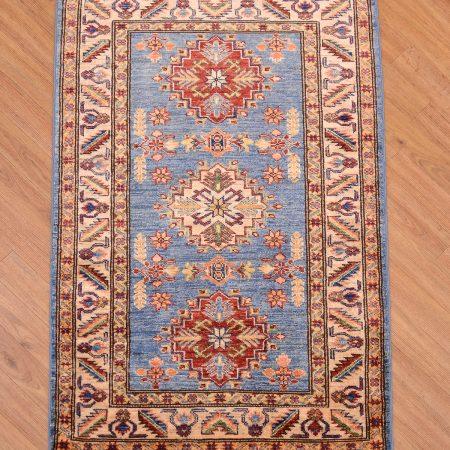 Attractive light blue fine Afghan Kazak Rug with striking 3 geometric medallion design.