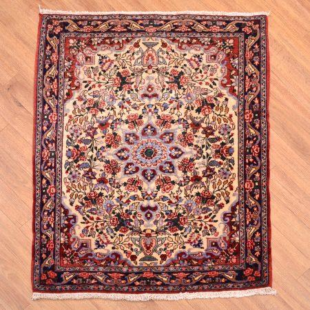 Old Persian Fine Bidjar Mat with floral medallion design on a beige background.