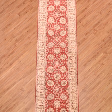 Hand-knotted Extra Long Afghan Ziegler Runner with all-over floral design on a red background.