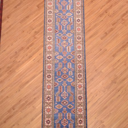 Stunning blue ground Fine Afghan Kazak Runner with traditional geometric decoration.
