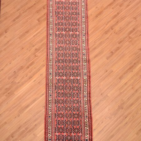 Classic handmade Persian Hosseinabad Runner with all over herati design decoration on a terracotta background.