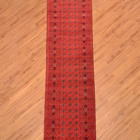 Traditional handmade Fine Afghan Mauri Runner with classic rich red colour and bokhara pattern.