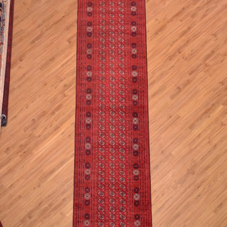 Traditional hand-knotted rich red Fine Afghan Mauri Runner with classic Bokhara pattern.