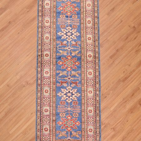 This Fine Afghan Kazak Runner is a real eye-catcher! It has the most amazing blue main colour with contrasting geometric medallions.