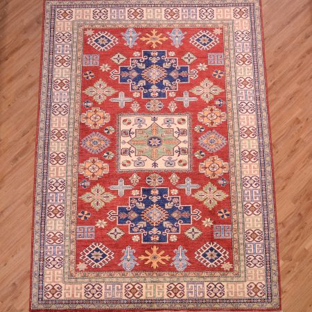 Vibrant handmade Afghan Fine Kazak Carpet with clear red field and geometric three medallion design with beige border.