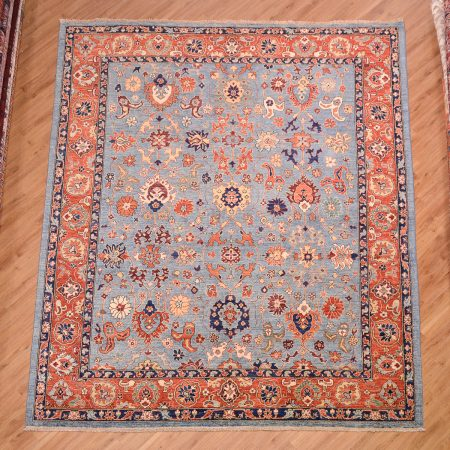 Handknotted Afghan Fine Aryana Carpet with all over floral pattern on a blue background with terracotta border.