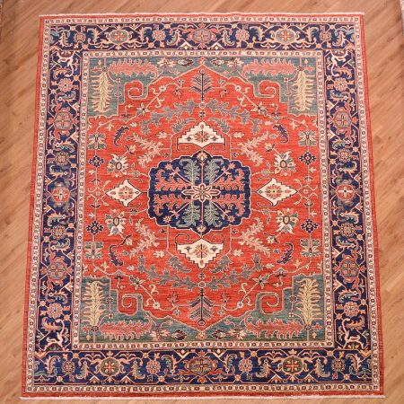 Handmade Afghan Fine Aryana Carpet with heriz design on an orangey-red background, with navy blue, green, beige and gold.