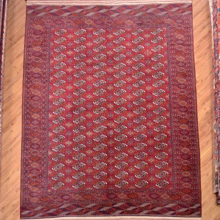 "Handknotted ""Russian"" Turkoman Bokhara Carpet with a theme of 108 guls on a red background."
