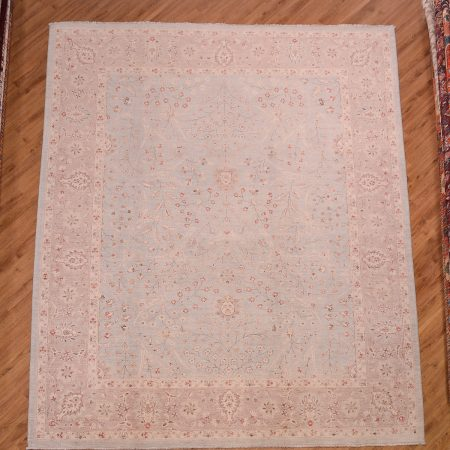 Pale handknotted Afghan Ferahan Carpet with gentle all over floral pattern on a soft duck-egg blue background.