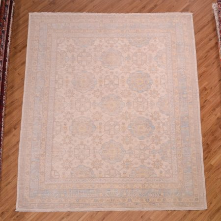 Afghan Khotan Carpet with attractive and gentle colour scheme of beige with soft blue and yellow.