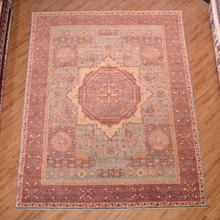 Intricately handknotted Afghan Fine Mamluk Carpet with medallion design and attractive colours of soft blue, terracotta and gold.