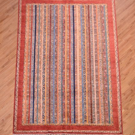 Handmade Afghan Shaal Carpet with all over design of multi-colour stripes surrounded by a plain rust-red border.