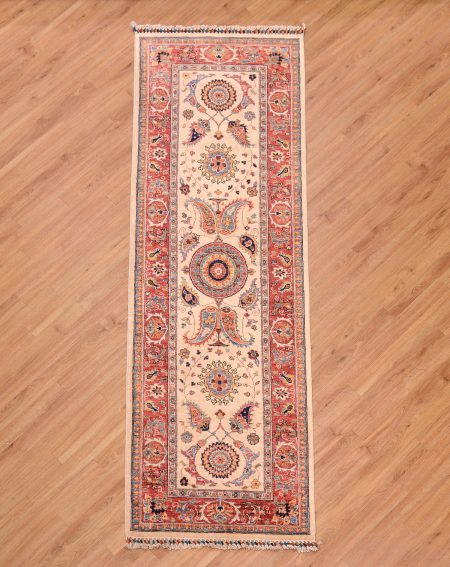 Eye-catching handmade & handknotted beige ground Afghan Suzani design Runner with large scale floral motifs based on Central Asian weavings.