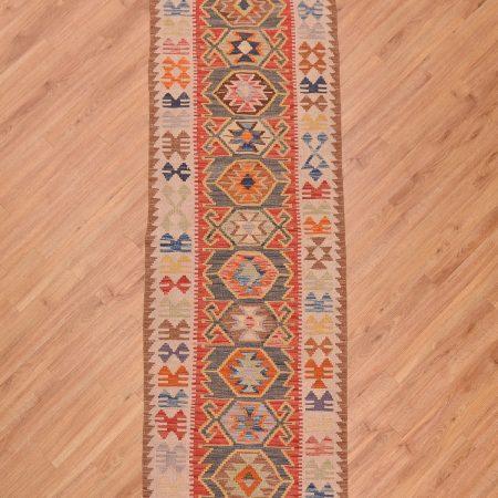 Handwoven flat weave Afghan Veg Dye Kelim Runner with multi-colour medallion patterns.