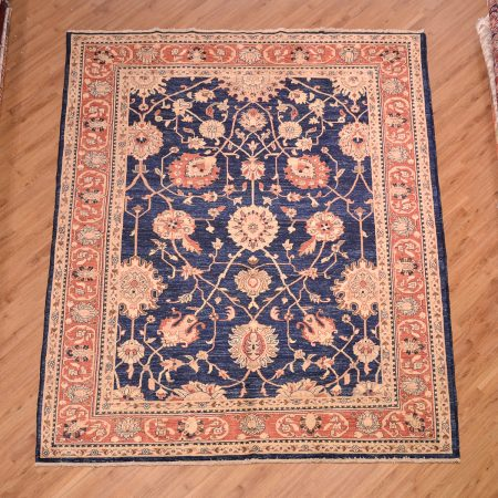 Blue ground with terracotta border Afghan Ziegler Carpet handmade with a handknotted wool pile.