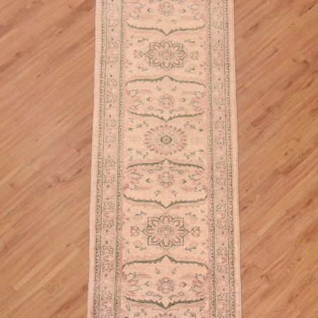 Attractive handmade Afghan Ziegler Runner with pleasing colour scheme of beige with green and characterful large scale floral pattern.