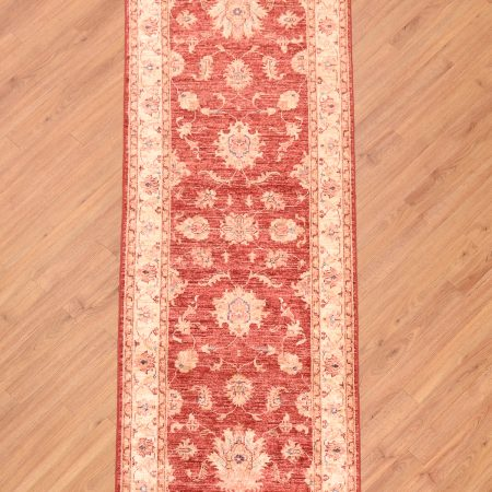 Elegant all over floral patterned handknotted Afghan Ziegler Runner with rust-red main colour with beige.