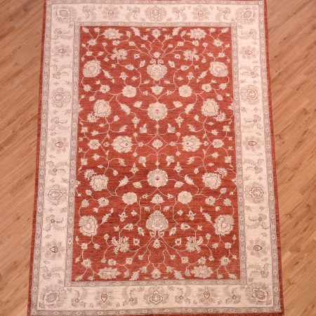 Handknotted Afghan Ziegler Carpet with rust ground with beige border.