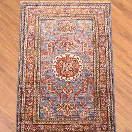 Handmade Afghan Fine Kazak Rug with medallion design on a light blue field with rust-red medallion & border.