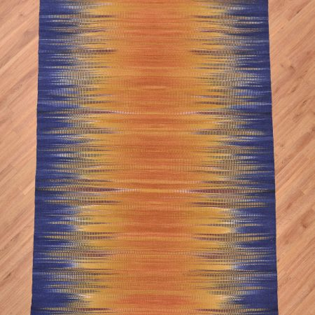 Stylish handwoven flat-weave Indian Modern Kilim Rug with merging colours of amber and blue.