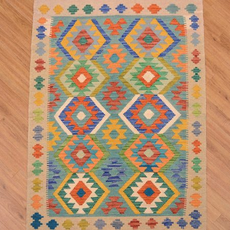 A funky handwoven flat weave Afghan Maimana Kelim Rug with jazzy colours and 2 rows of 5 medallions.