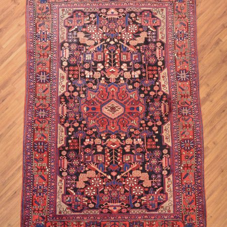 Traditional handmade Persian Nahavand Carpet with medallion design.