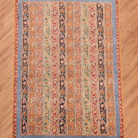 Handmade modern Afghan Shaal Rug with a multi-colour design of stripes including boteh motifs.