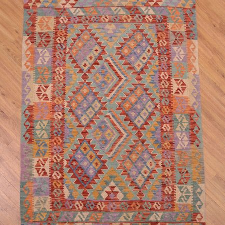 Handwoven Afghan VegDye Kilim Rug with all over geometric pattern.