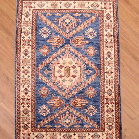 Superb handmade Afghan Fine Kazak Rug with medallion design on a blue field.