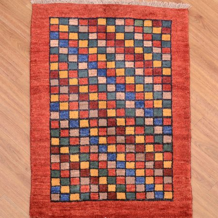 Funky modern handmade Persian Chequerboard Gabbeh Rug with chequerboard grid pattern enclosed by a plain terracotta border.