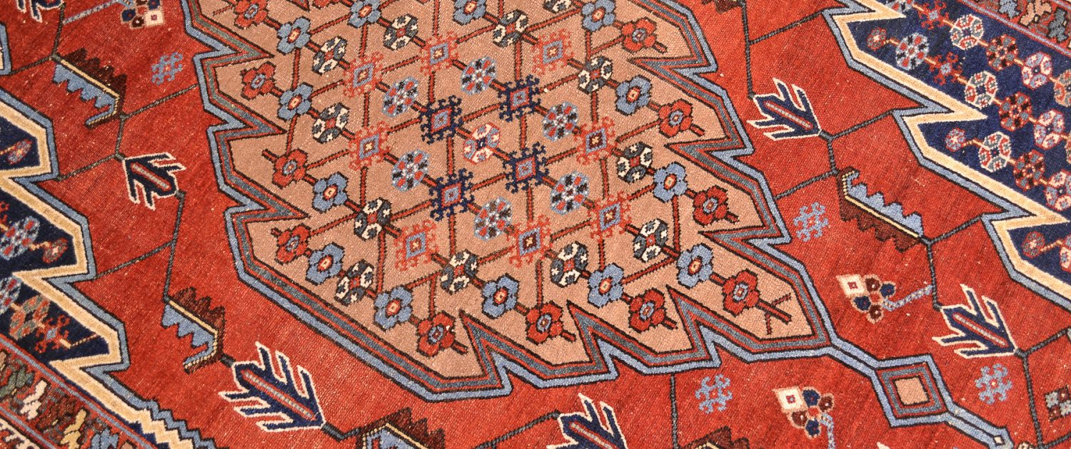 "Captivating Persian Antique Mazlaghan Rug made circa 1920 with iconic ""lightening"" design and wonderful vibrant colours."