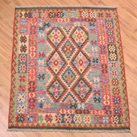 Such beautiful colours! This handwoven Afghan Veg Dye Kilim Rug has a stunning traditional all over design.
