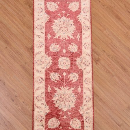 Reduced Price Afghan Ziegler Strip with red background and beige border.