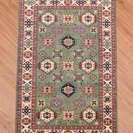 Handmade & great value Afghan Kazak Rug with all over design and green main colour.