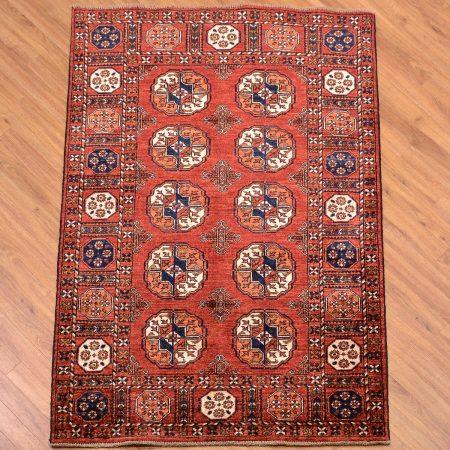 Traditional handmade Afghan Ersari Rug with 10 gul design on a rust field.