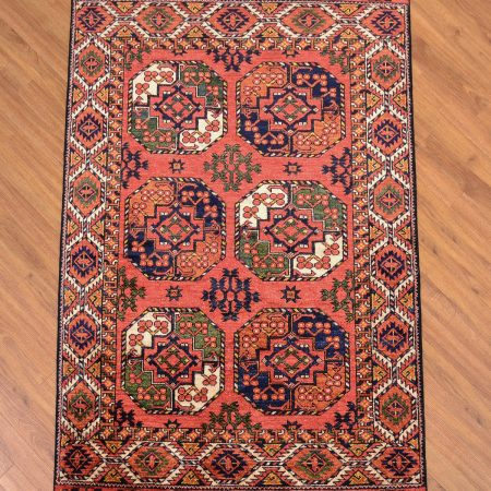 Eye-catching handmade Afghan Ersari Rug with 6 large fil pai guls on a terracotta background.