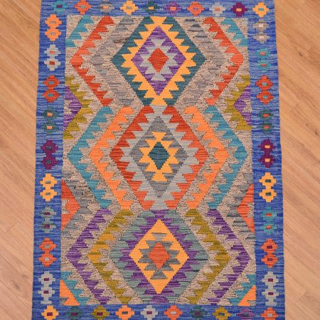 Jazzy Afghan Maimana Kilim Rug with bright three medallion design laid against a two-tone salt and pepper background with blue main border surround.