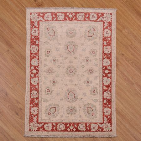 Exquisite handmade Afghan Ziegler Rug with classic colours of beige with delicate floral pattern surrounded by a red border.