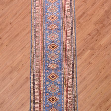 Eye-catching handmade Afghan Fine Kazak Runner with 13 small medallions placed on a blue background.