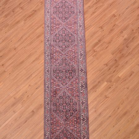 Top quality handknotted Persian Fine Narrow Bidjar Runner of 6 medallion design and traditional herati pattern.
