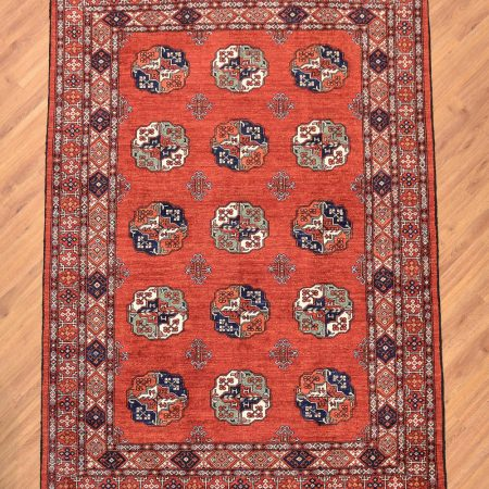 Traditional handmade Afghan Ersari Rug with classic pattern of 15 guls on a rust field.