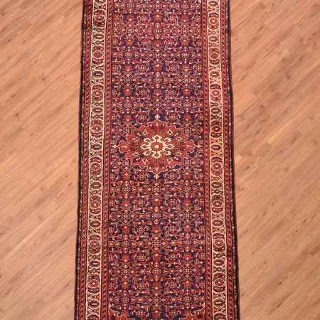 Traditional handmade/handknotted Persian Hamadan Wide Runner with medallion design and herati pattern on a dark blue background.