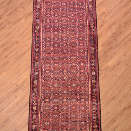 Traditional handmade Persian Hosseinabad Wide Runner with all over herati pattern on a red/teracotta background.