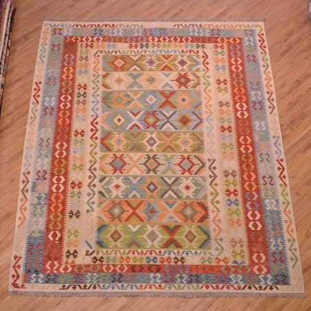 Handwoven slit-weave Afghan Veg-Dye Kilim rug in a large size with soft colours including terracotta, beige, green and blue.