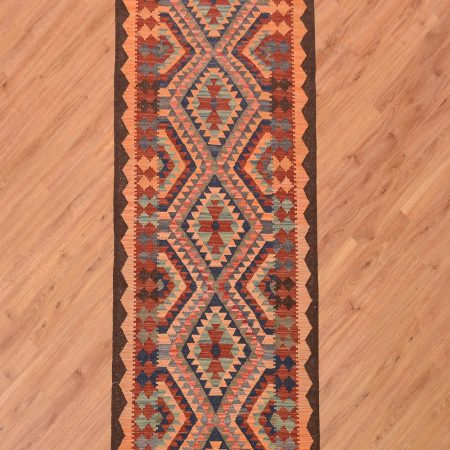 Handwoven Afghan Veg Dye Kilim Runner with 6 medallion design and colours including orange and brown.