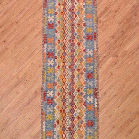Jazzy handwoven Afghan Veg Dye Kilim Runner with vibrant colours and scale scale design.