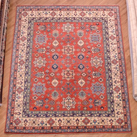 Hand-knotted Afghan Kazak Carpet with all over design, red/rust field and beige main border.